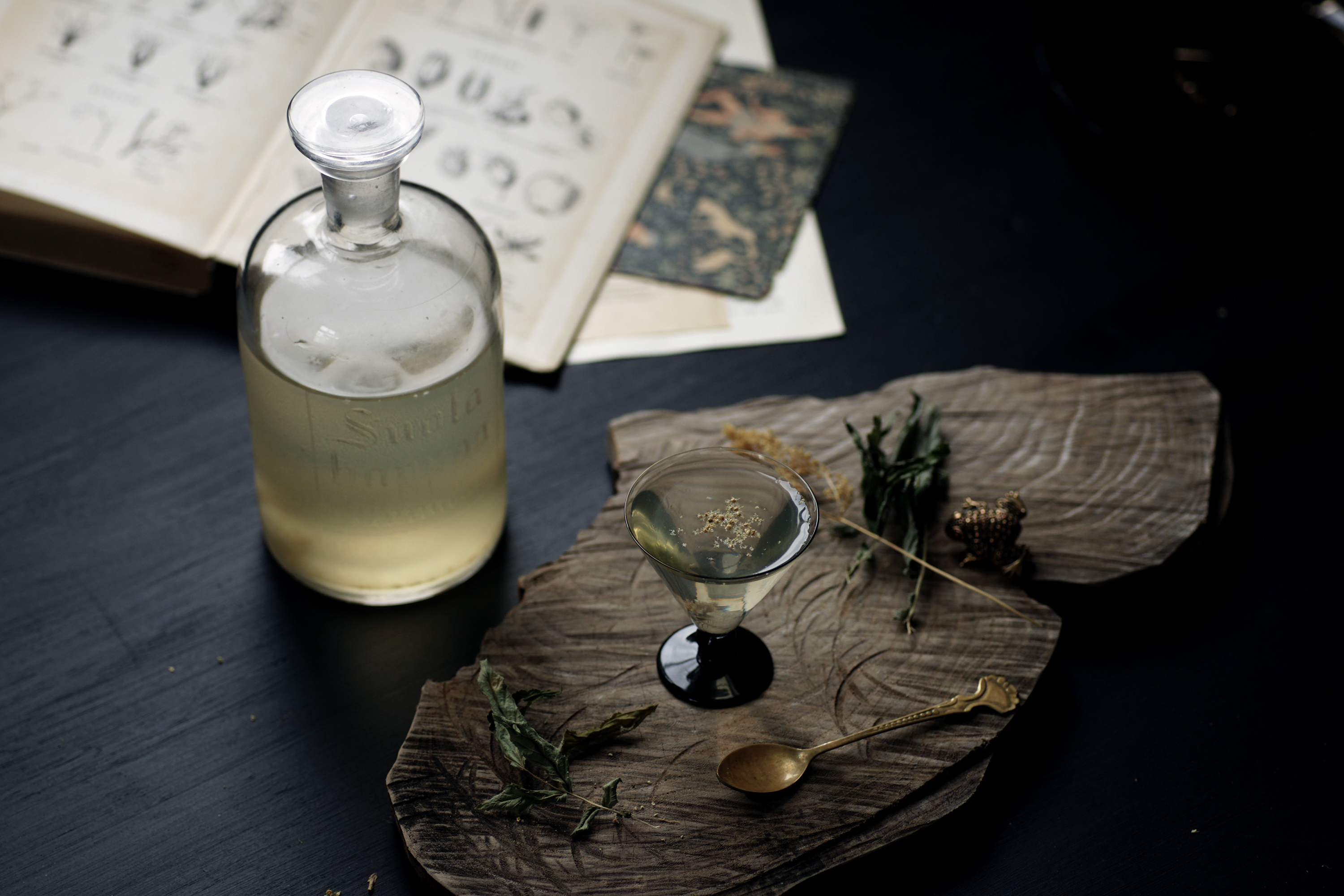 Botanical mead in old glass bottle and small glass